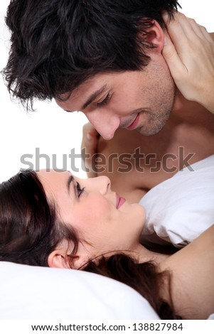 Husband and wife staring into each other's eyes - stock photo
