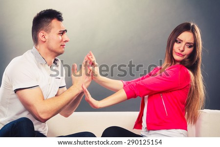 Husband apologizing wife. Unhappy, upset, angry, mad woman refuses apology. Boyfriend trying to convince girlfriend. Man asking for forgivness. Conflicted couple. Relationship problem. - stock photo