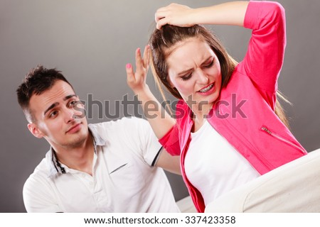 Husband apologizing wife. Upset, angry, mad woman refuses apology. Boyfriend trying to convince heartbroken girlfriend. Man asking for forgiveness. Conflicted couple. Relationship problem. - stock photo