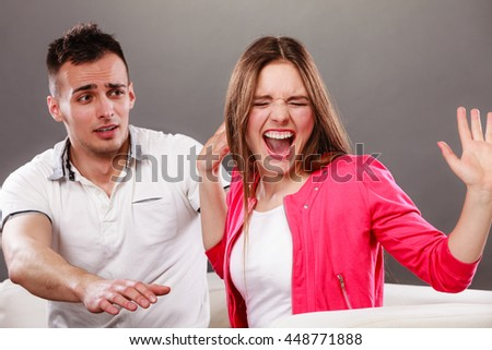 Husband apologizing wife. Upset, angry, mad woman refuses apology. Boyfriend trying to convince heartbroken girlfriend. Man asking for forgivness. Conflicted couple. Relationship problem. - stock photo