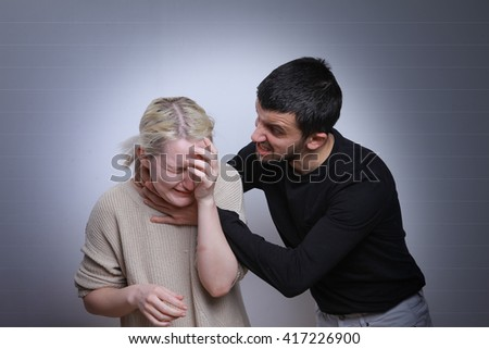 Husband beats wife. Family quarrels, violence in the family - stock photo