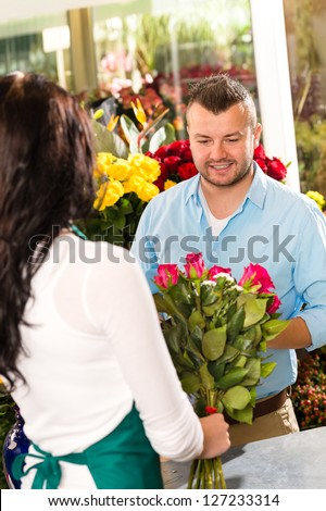 Husband buying roses bouquet romantic flower market florist - stock photo