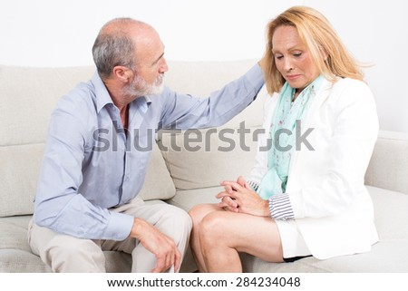Husband comforting his wife - stock photo