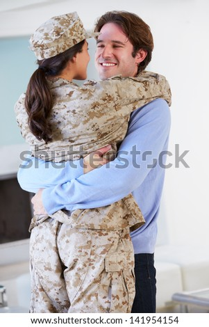 Husband Greeting Military Wife Home On Leave - stock photo