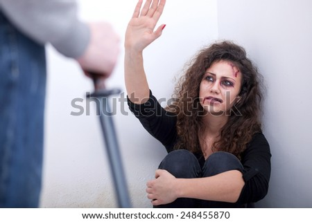 Husband holding a knife intimidates his wife - stock photo