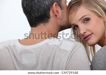 Husband kissing young wife - stock photo