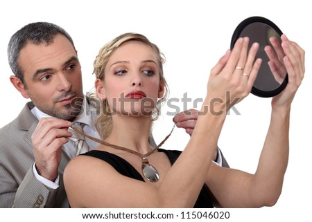husband offering his wife a necklace - stock photo