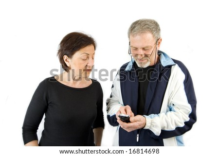 Husband on the Phone checking an incoming text message while wife looking over his shoulder- Isolated