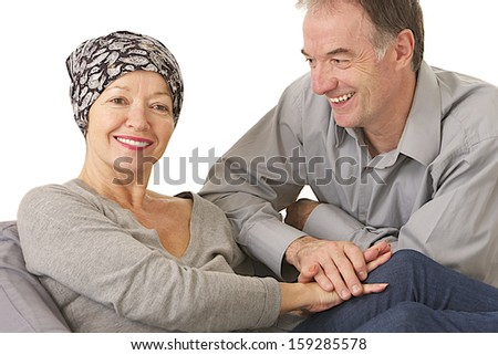 husband supportive attitude after wife' s chemotherapy -  woman wearing protective headscarf - stock photo