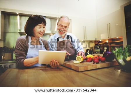 Husband Wife Cooking Searching Menu Tablet Concept - stock photo