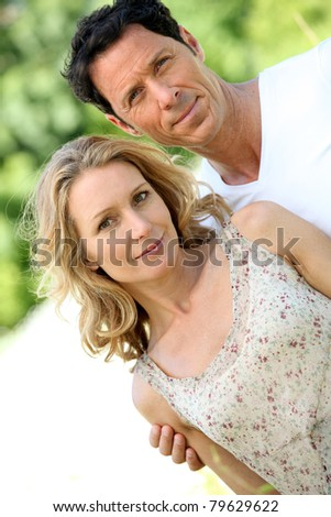 Husband with arm around wife. - stock photo