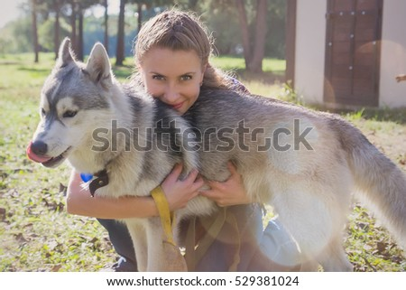 Husky dog with the owner enjoying the nature