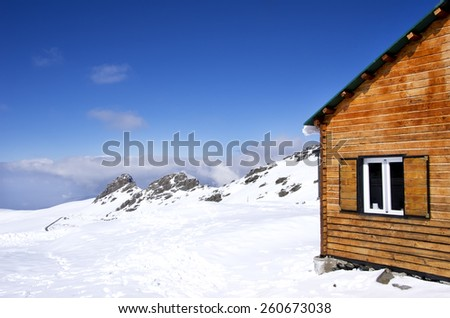 Hut and mountain in the sierra nevada - stock photo