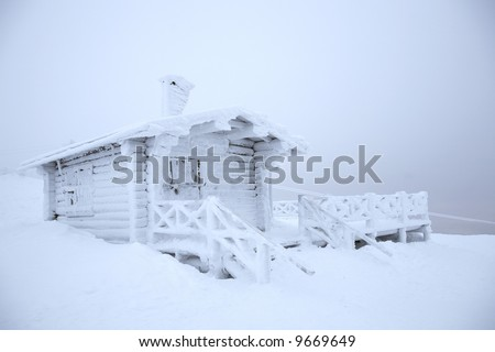 hut covered with snow - stock photo