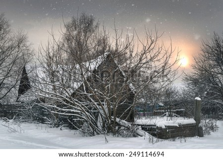 Hut from a fairy tale. Small rural house in the winter snowy forest under snow - stock photo