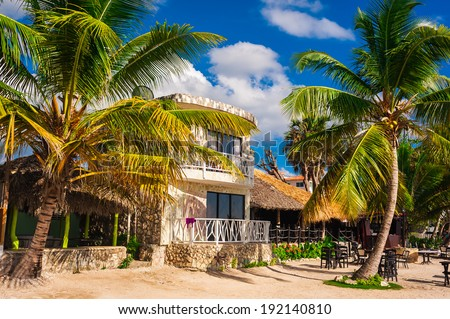hut in a tropical jungle. jungle lodge. Tropical beach house in Dominican Republic. summertime vacation. tropical panoramic beach. native typical tropical island. caribbean life. boat on the beach - stock photo