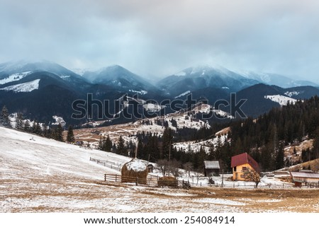 Hut in the snow.  background with snowy landscape. Ukraine - stock photo