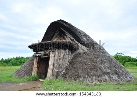 Hut of ancient human tribe, north of Japan - stock photo