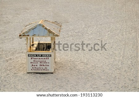 hut on the beach, offering water sport rentals - stock photo