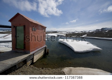 Hut or Out house on a jetty, near Bellingshausen station, Russian base, Antarctica