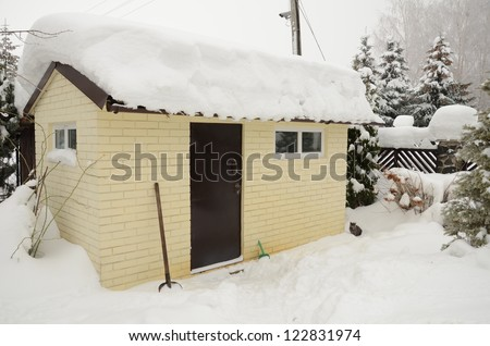 hut under snow - stock photo