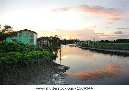 Huts and river in magic hour