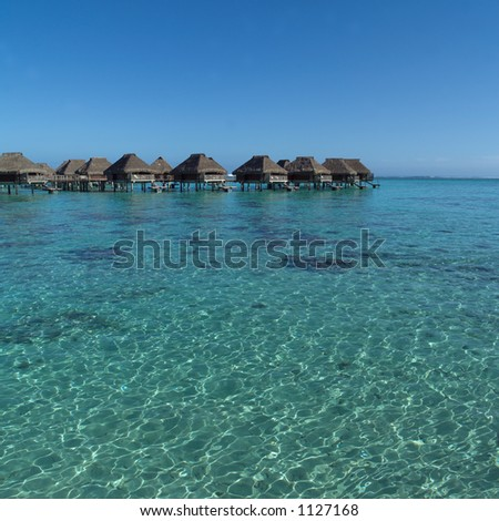 Huts in a Row over Ocean at  Moorea in Tahiti