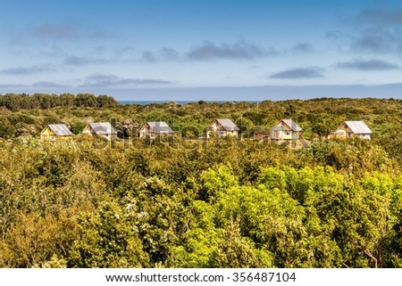 Huts of tourist resort in Chiloe National Park, Chile