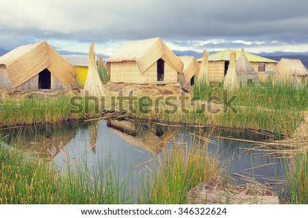 Huts on Uros floating islands on high altitude lake Titicaca. Andes. Peru. - stock photo