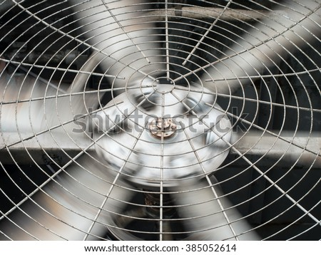 HVAC (Heating, Ventilation and Air Conditioning) spining blades / Closeup of ventilator / Industrial ventilation fan background / Air Conditioner Ventilation Fan / Ventilation system - stock photo