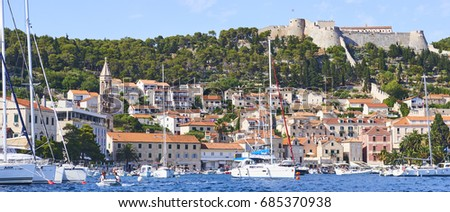 HVAR, CROATIA - July 10, 2017: Yachts and boats at Hvar harbour in old town Hvar. Hear is very popular tourist destination on Dalmatia of Croatia.