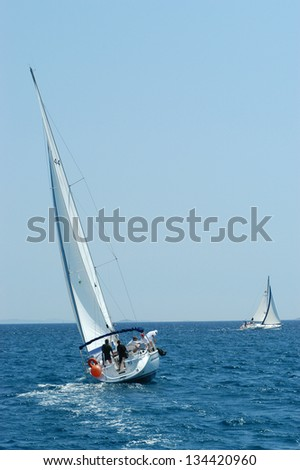 HVAR, CROATIA - MAY 20: Unidentified people participate the Republic Cup international sailing competition on the Adriatic sea on May 20, 2003 in Hvar, Croatia. - stock photo