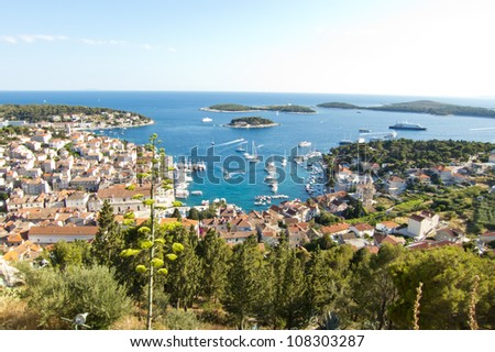 Hvar, harbor of old Adriatic island town. panoramic view. Popular touristic destination of Croatia.