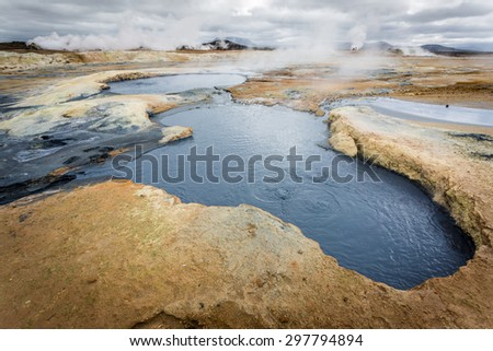 Hverir, Geothermal area in northern Iceland. Boiling mud and steam geyser - stock photo