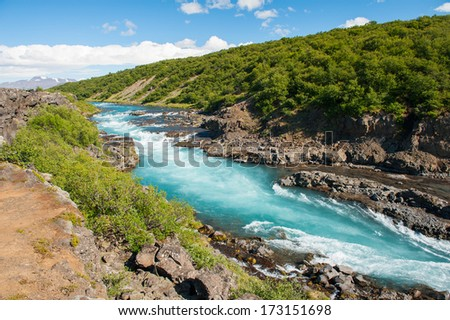 Hvita river with a incredibly blue water near Hraunfossar waterfalls, Iceland - stock photo