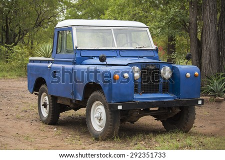 Hwange National Park, Zimbabwe - 05 April 2015: Land Rover old model 4 WD vehicle in Hwange National Park of Zimbabwe. Vintage car style.