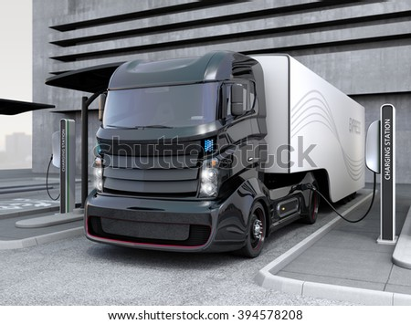 Hybrid electric truck being charging at charging station - stock photo