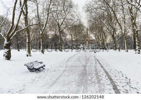 Hyde Park covered in snow with Albert Memorial in the background after three days of blizzards. - stock photo