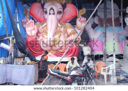 HYDERABAD,AP,INDIA-AUGUST 23: Making of  ganesha idol for the hindu festival ganesha chathurthi August 23,2011 in Hyderabad,India.Thousands of Idols in different sizes are made every year. - stock photo