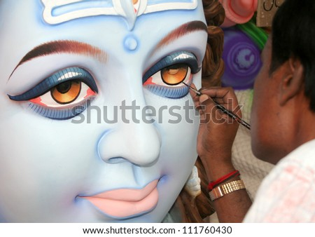 HYDERABAD,AP,INDIA-SEPTEMBER 02:Artists making the ganesha idol for  hindu festival ganesha chathurthi September 02,2011 in Hyderabad,India.Thousands of Idols in different sizes are made every year. - stock photo