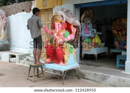 HYDERABAD,AP,INDIA-SEPTEMBER 9:Artists making the ganesha idol for the hindu festival ganesha chathurthi on September 9,2012 in Hyderabad,India.Idols in different sizes and shapes are made every year. - stock photo