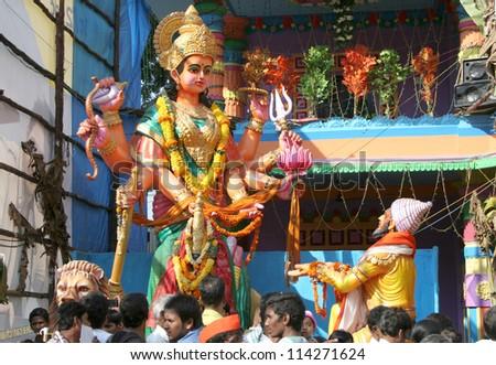 HYDERABAD,AP,INDIA- SEPTEMBER 28:People pray to Tulja Bhavani at 58 feet high Lord Ganesh idol, during ganesh chathurthi Hindu festival,of khairatabad,on 28,September 2012 in Hyderabad,India. - stock photo