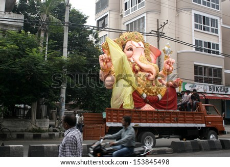 HYDERABAD,AP,INDIA- SEPTEMBER 8:People transport Ganesha idol for Hindu festival ganesha chathurthi September 8,2013 in Hyderabad,India.Devotees perform 10 day puja in Thousands of neighbourhoods. - stock photo