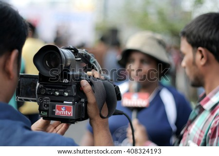 HYDERABAD,INDIA-APRIL10: TV channel press videographer shoot the interview of the organiser on raahgiri day,open roads program on March 10,2016 in Hyderabad,India.