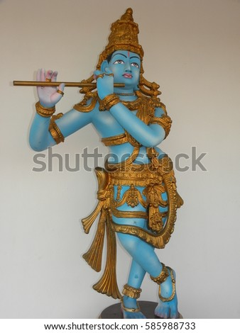 Hyderabad, India - Jan 1, 2009 Blue and golden color statue of Lord Krishna with flute at Ramoji Film City