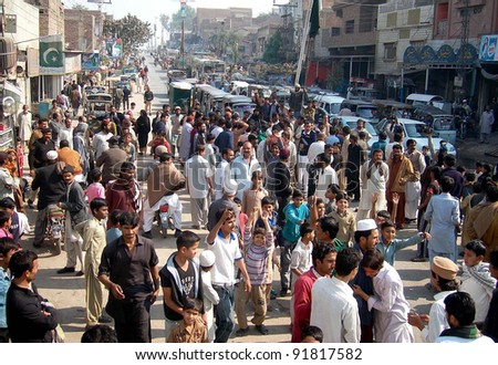 HYDERABAD, PAKISTAN, JAN 02: Residents of Ghareebabad chant slogans against non- supply of Sui gas in their area during protest demonstration at National Highway in Hyderabad, January 02, 2012.