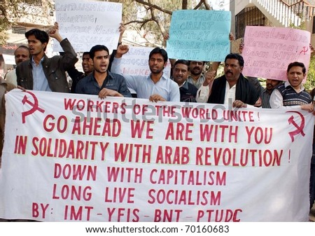 HYDERABAD, PAKISTAN - JAN 30: Supporters of Unemployed Youth Movement chant slogans during a protest demonstration to show solidarity with Arab Revolution on January 30, 2011in Hyderabad.