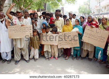HYDERABAD, PAKISTAN-SEPT 02: Flood affected people protest in favor of their  demands during a demonstration outside Hyderabad press club on Thursday, September  02, 2010. (Aftab Ahmed/PPI Images). - stock photo