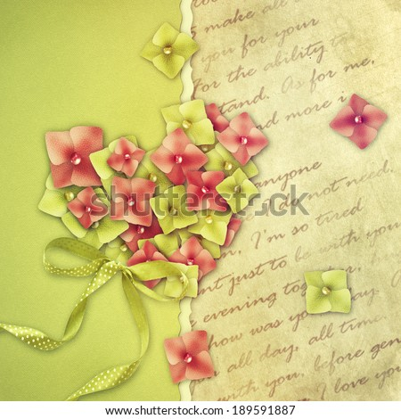 Hydrangea flower petals in the shape of a heart on an antique vintage paper background