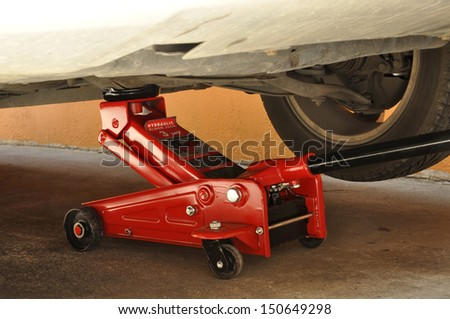 Hydraulic car jack to lift car for change the wheel.  - stock photo